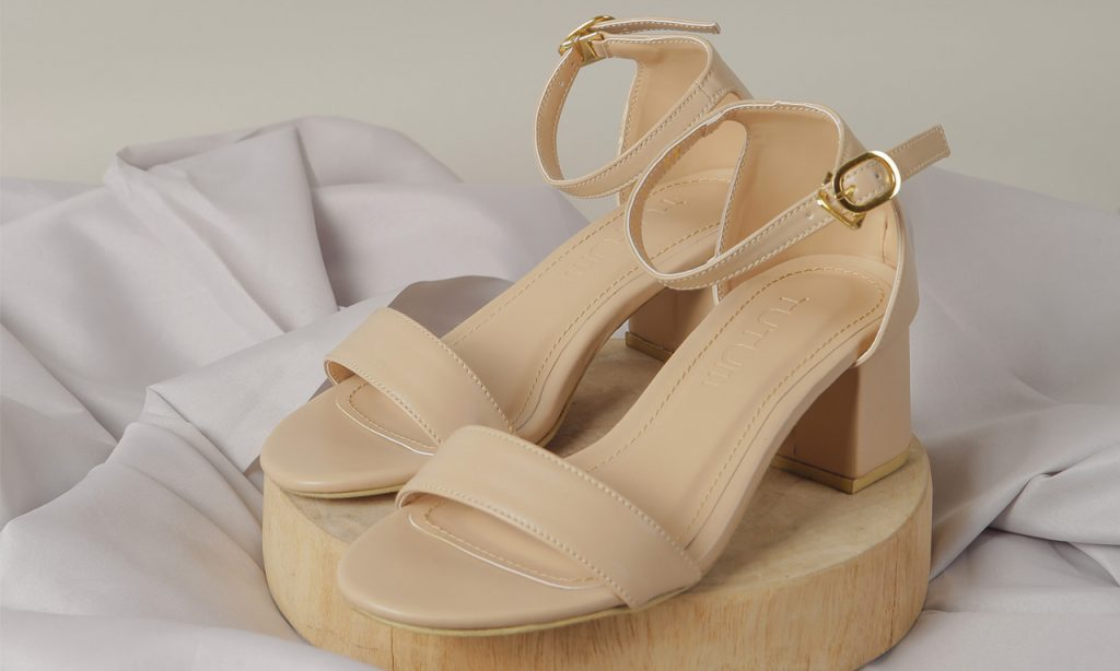 slingback heels perched on a piece of circular wood