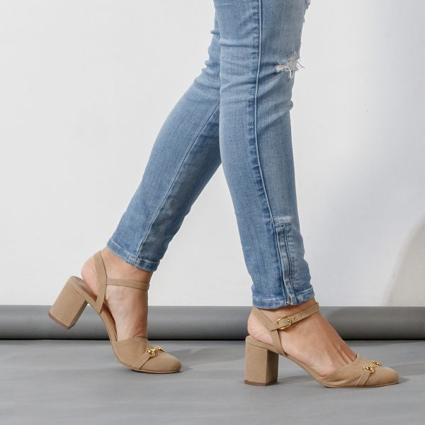 Shot of a woman wearing jeans in slingback shoes